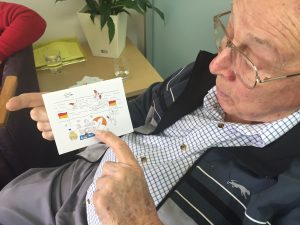 Wal shows one of John's cards