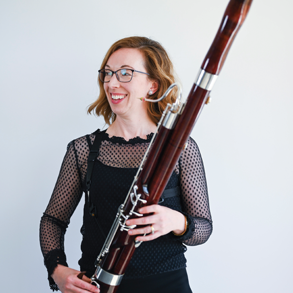 Woman holding a bassoon